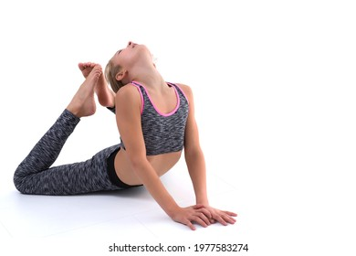 The gymnast perform an acrobatic element on the floor.
