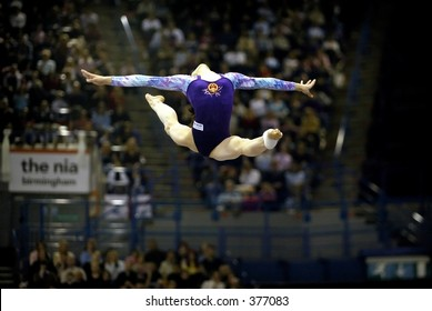Blonde gymnast performs gymnastics - 3 3
