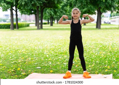 Gymnast schoolgirl warming up in a grass park before performing complex exercises. Series of photos