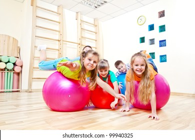 Gymnastic balls and kids on them