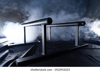 gymnastic bars for push-ups isolated on back and smoked background