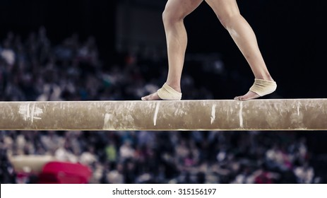 Gymnastic feet on the beam. Montpellier, France.