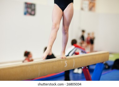 A gymnastics competitor on the balance beam.