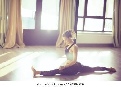 gymnastics training girl / gym girl doing gymnastics, stretching, healthy body, sports style training