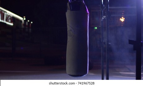 Gym,Punching bags. Punching bags in boxing room, sport. Punching bag at the dark sports ground