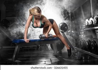 Gym.Sporty girl posing