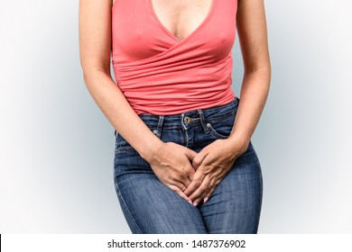 Gynecologic problems, urinary incontinence, female health. Woman holds hands  between her legs