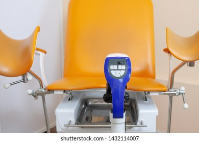 Gynecological chair and colposcope in a medical office.