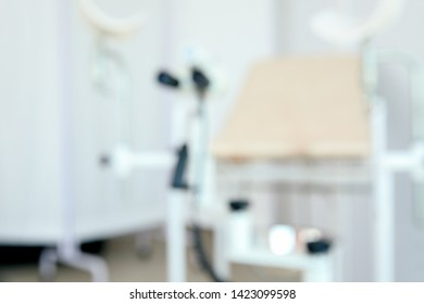 Gynecological chair with modern colposcope in clinic, blurred view