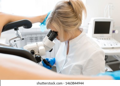 A gynecologist examines a patient on a gynecological chair. Workflow of a gynecologist.