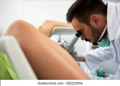 Gynecologist examining a patient with a colposcope, check up healthcare patient