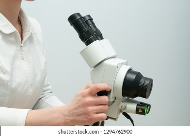 Gynecologist working with colposcope in clinic