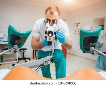 Gynecologist working with colposcope in clinic. Medical background