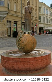 Gyor, Hungary - May 29, 2018: Statue and fountain of the dragon slayer St. George in Gyor