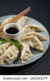 Gyoza dumplings on plate, Asian food