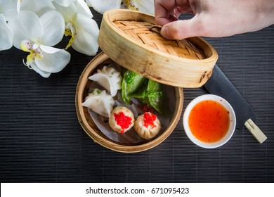 Gyoza, Japanese Dumplings. Steam Chinese food of the steaming gyoza in wicker basket