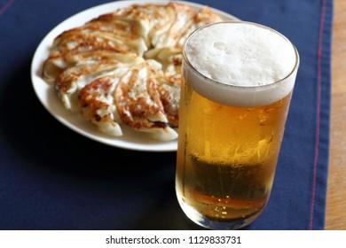 Gyoza(Japanese pan-fried dumplings) and beer