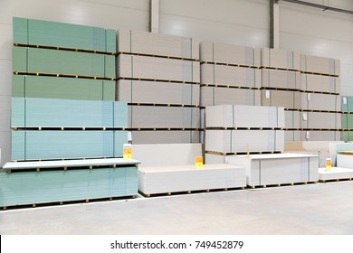 gypsum board stacks at indoor warehouse