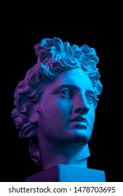 Gypsum copy of ancient statue Apollo head isolated on black background. Plaster sculpture man face. - Shutterstock ID 1478703695