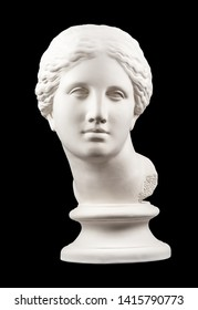 Gypsum copy of ancient statue Venus head isolated on black background. Plaster sculpture woman face.