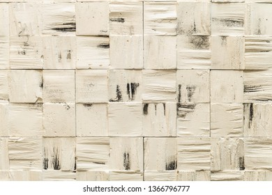 Gypsum facing tile on the wall. Construction material.