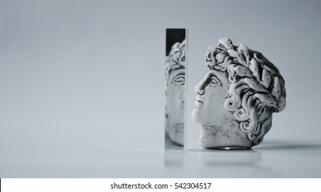 Gypsum head of Caesar on white background with prism