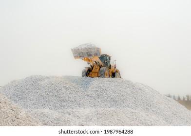 Gypsum Mining. heavy wheel loader loading. Front End Loader on Stock Pile.