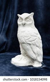 Gypsum sculpture owls