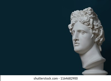 Gypsum statue of Apollo's head. Man. Statue. Blue statue of Apollo's head. Head.