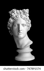 Gypsum statue of Apollo's head. Man. Statue. Earphone. Isolated. Head.