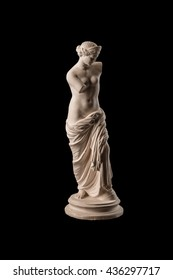 Gypsum statue of Venus on a black background