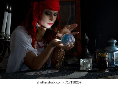 gypsy fortune teller wonders on the magic ball,gypsy fortune teller read the cards and  takes money for fortune-telling