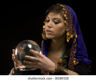 Gypsy fortune-teller uses a crystal ball to foertell the future