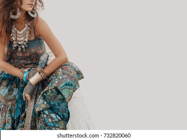 gypsy hippie styled young woman with guitar