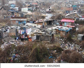 Gypsy slum in Belgrade, Serbia, town city urban settlement, poverty, garbage or junkyard, houses and shacks made of wood or metal