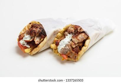 Gyro pita, shawarma, take away, street food. Two pita bread wraps with meat, traditional greek turkish food isolated on white background