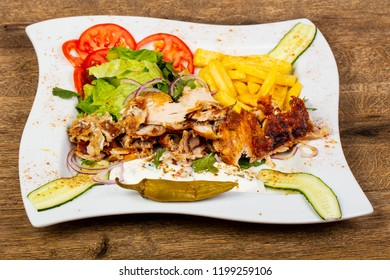 Gyros on the plate with vegetables