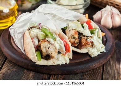 Gyros souvlaki wrapped in a pita bread with french fries. Greek dish