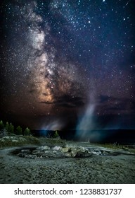 Gyser an active volcano with milky way and stars in Yellowstone National Park Montana MT USA