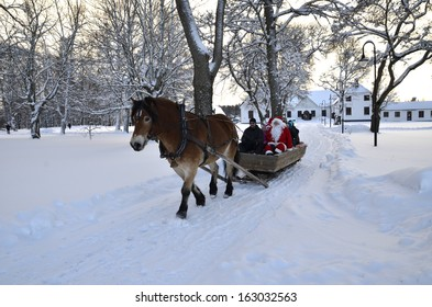 GYSINGE, SWEDEN - DECEMBER 9: Unidentified Santa Claus goes to Christmas market with a horse Official name is Gysinge julmarknad and organization are vi i Gysinge on December 9, 2012 in Gysinge Sweden