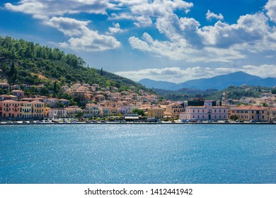 GYTHEIO, LACONIA, GREECE - AUGUST 2018: View of the picturesque coastal town of Gythio from the deck of a ferry boat leaving the port. Peloponnese, Greece in August 2018