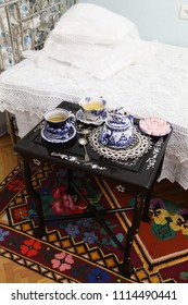 Gzhel Tea set with sweets on Chinese tea table