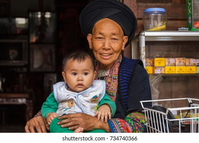 HA GIANG, VIETNAM - 5/24/2016: Portrait of a Hmong Hill Tribe woman and child in Ha Giang, Vietnam