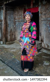 Ha Giang, Vietnam - August 18, 2019 : Women Hmong Lolo ethnic minorities more crafted an elaborately identity traditional colorful textile cultural costume has 4000 sewn triangles tribal dress
