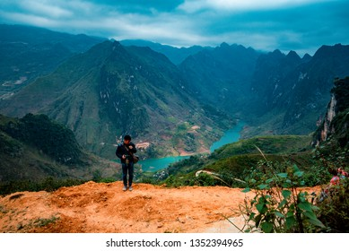 Ha Giang, VIETNAM - FEB 23, 2019:  tourists Vietnamese posing for photo with stunning view of the Nho Que river and Meo Vac landscape surrounded by mountains from the Ma Pi Leng pass, Viet Nam