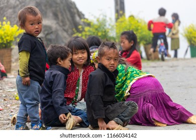 Ha Giang, Vietnam - March 18, 2018: Hmong ethnic minority children playing on a top of a foggy mountain in northern Vietnam. Credit: Dino Geromella/Shutterstock