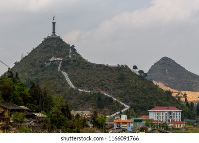 Ha Giang, Vietnam - March 18, 2018: Hill with Vietnamese flag at the northernmost point of Vietnam and the border with China. Credit: Dino Geromella/Shutterstock