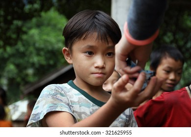 Ha Giang, Vietnam - September 18, 2015: Hmong children in Vietnam, In the northern province of Ha Giang in Vietnam. An area adjacent to China.