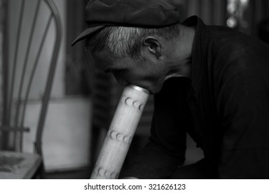 Ha Giang, Vietnam - September 18, 2015: Black and white of life photography in Vietnam, Vietnamese were smoking in the northern province of Ha Giang in Vietnam. An area adjacent to China.