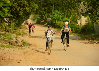 Ha Giang, Vietnam-Sept 10, 2018:Daily life Unidentified group of children going back from school and riding bike on country road in Ha Giang, Vietnam.